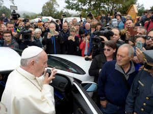 Pope Francis talks to people of Amatrice using a car loudspeaker in Amatrice, Italy, October 4, 2016. REUTERS/Osservatore Romano/Handout via Reuters ATTENTION EDITORS - THIS IMAGE WAS PROVIDED BY A THIRD PARTY. EDITORIAL USE ONLY. NO RESALES. NO ARCHIVE. - RTSQNE0