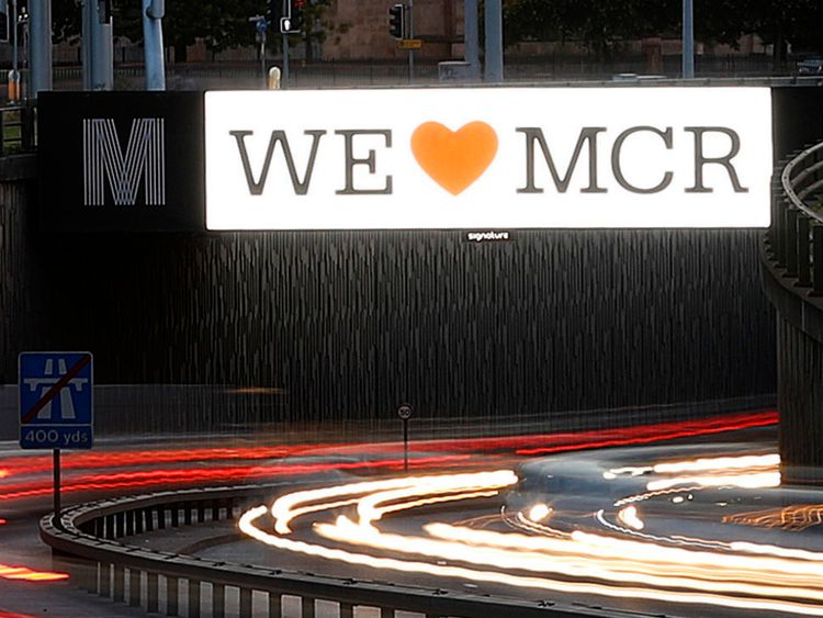 """A """"We Love Manchester"""" sign on the Mancunian Way in Manchester"""