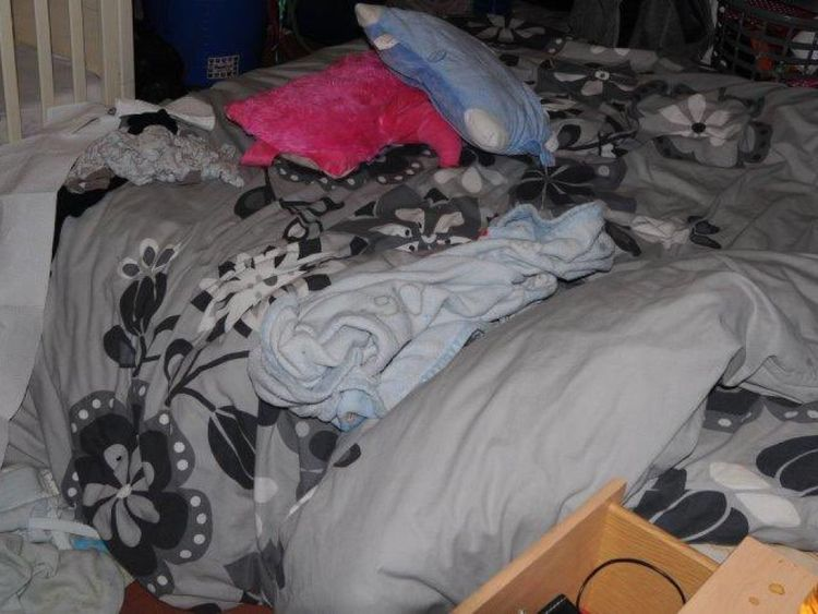 The coroner released a picture of the bed where Paul Worthington is said to have placed her before she collapsed and died