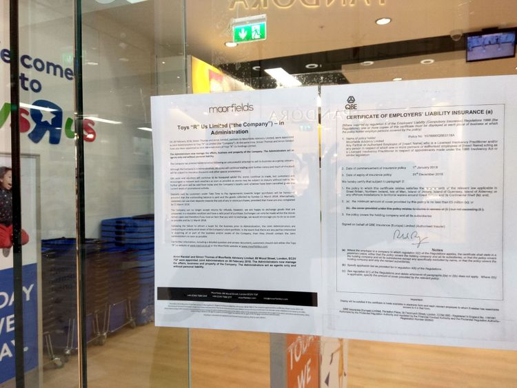 A notice informing customers of the collapse of Toys R Us is stuck on the window of its High Wycombe store