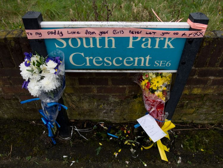 Floral tributes for Henry Vincent are attached to a road sign opposite the home of Richard Osborn-Brooks