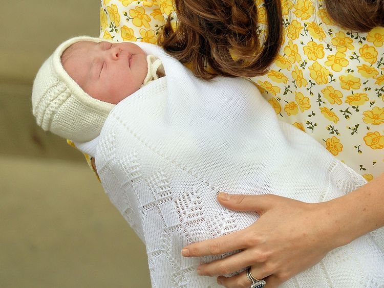 Catherine holds Princess Charlotte outside the Lindo wing