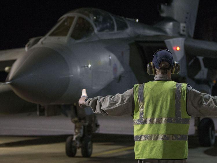 An RAF Tornado taxis into its hangar at RAF Akrotiri after conducting airstrikes