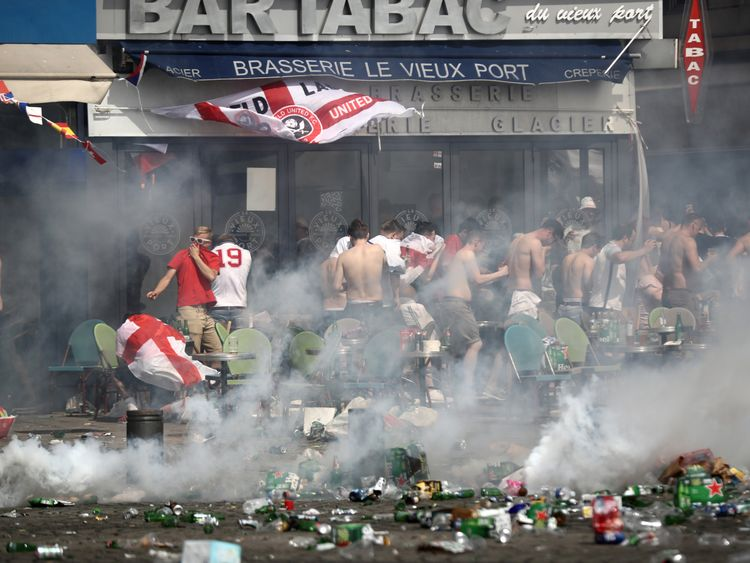 England fans react after police sprayed tear gas in Marseille