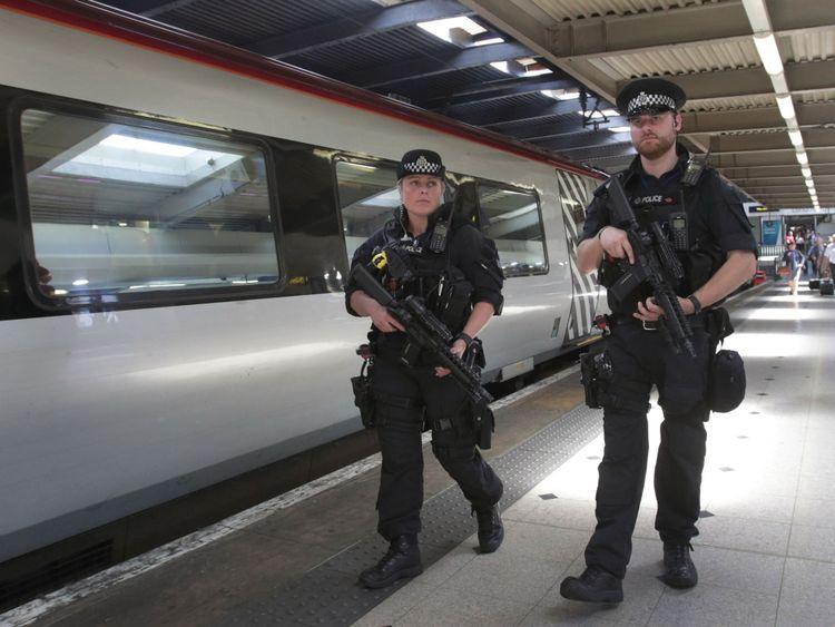 Armed police patrol transport hubs in London