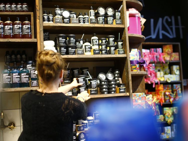 People stand inside a Lush cosmetics store in Berlin