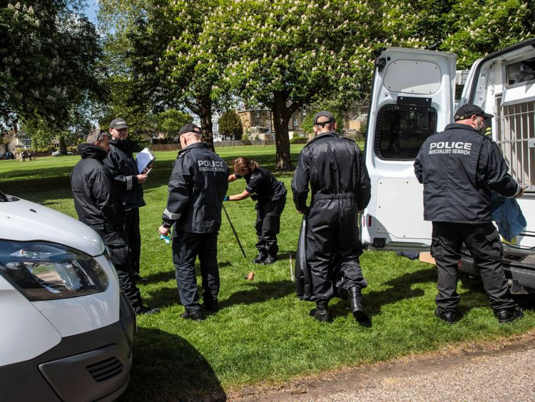 Police search teams work along The Long Walk at Windsor Castle ahead of the royal wedding