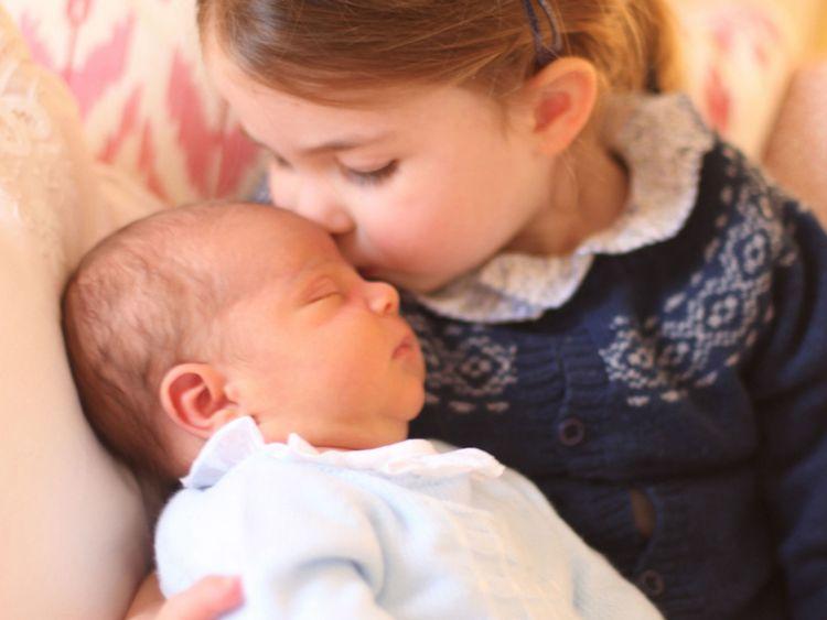 Princess Charlotte holding Prince Louis on her birthday