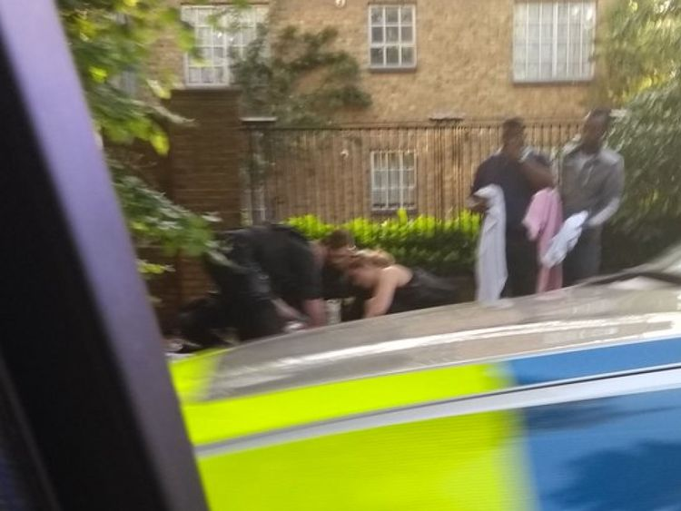 Someone being treated at the scene of the Peckham incident