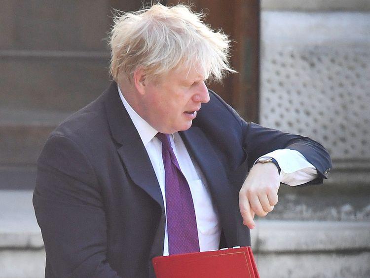 Boris Johnson walks to Downing Street