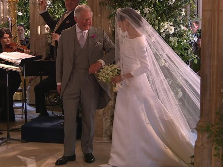 Tears from Meghan's mum as Charles walks the bride down the aisle