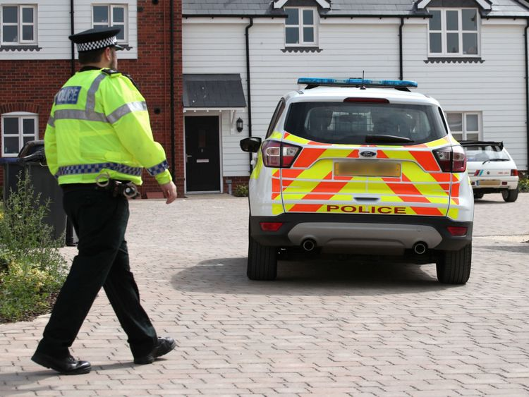 Police activity outside a block of flats on Muggleton Road in Amesbury