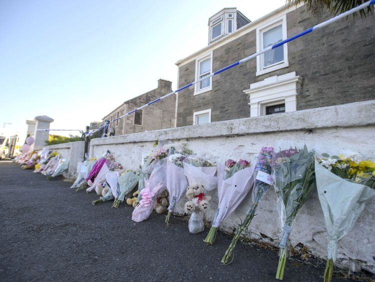 Flowers are left outside the house that Alesha went missing from