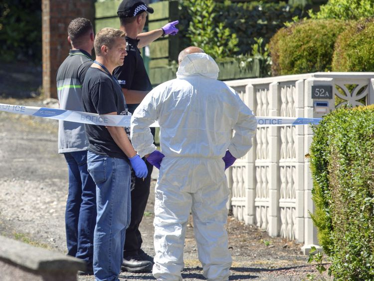 Forensic officers at the police cordon in Ardbeg Road on the Isle of Bute