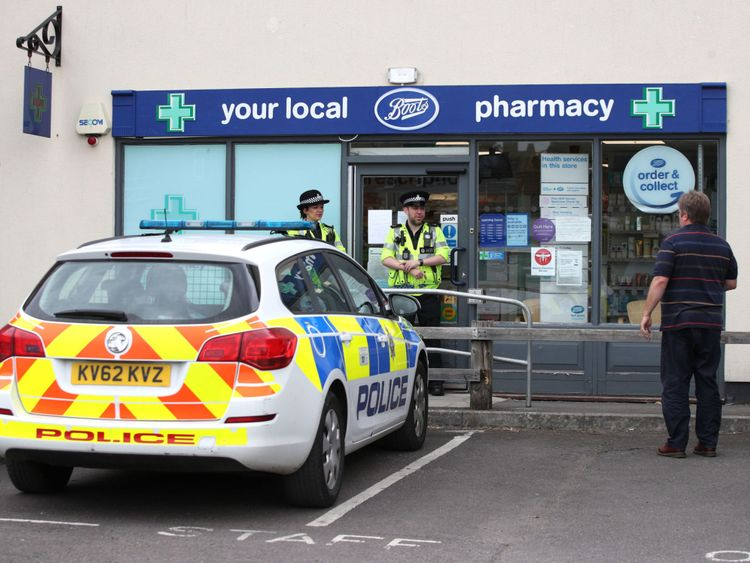 Police officers stand outside Boots pharmacy, near to the Barcroft Medical Centre in Amesbury, Wiltshire, where a major incident has been declared after it was suspected that two people might have been exposed to an unknown substance. PRESS ASSOCIATION Photo. Picture date: Wednesday July 4, 2018. Police say that the man and woman, both in their 40s, are in a critical condition at Salisbury District Hospital. See PA story POLICE Amesbury. Photo credit should read: Yui Mok/PA Wire