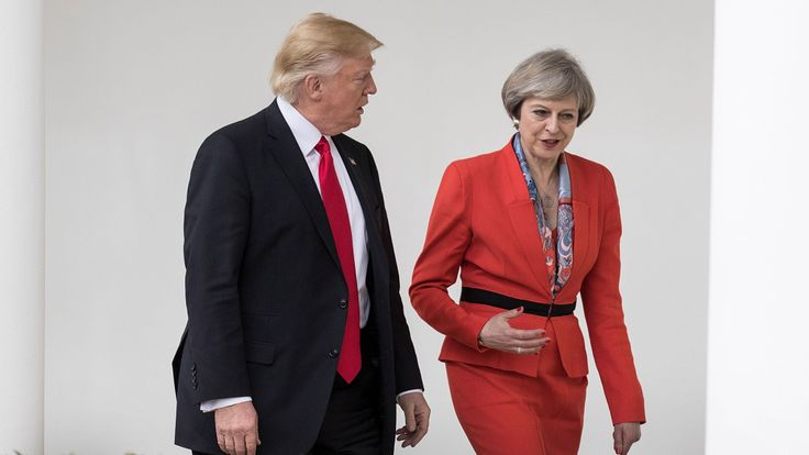 Theresa May and Donald Trump walk along The Colonnade in the White House
