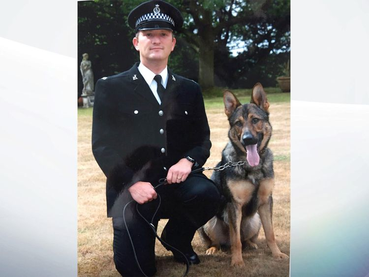 PCDave Wardell and his police dog, Finn, were chasing a robbery suspect in 2016 when they were attacked with a knife.- GIVEN BY PR