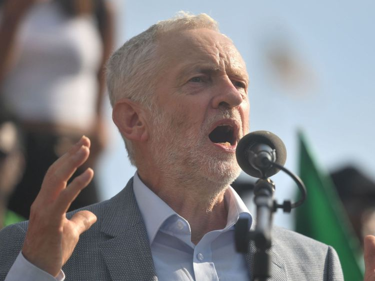 Jeremy Corbyn speaks to demonstrators marching through London during protests against the visit of Donald Trump