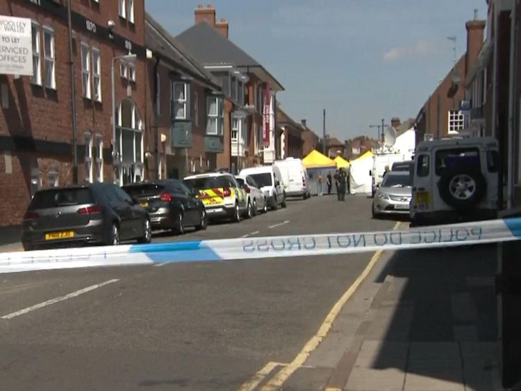 A heavy police presence remains at the home of one of the victim's
