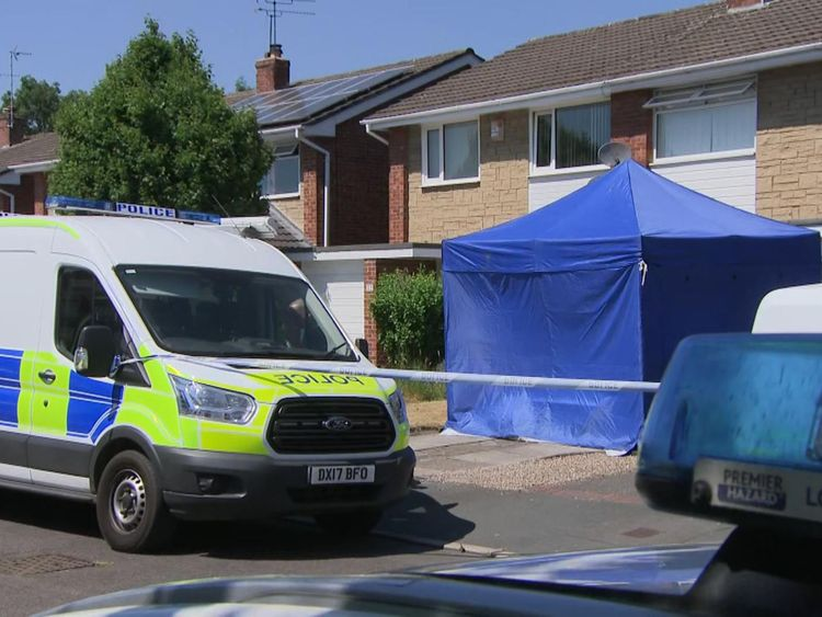 A forensics tent has been set up outside one home