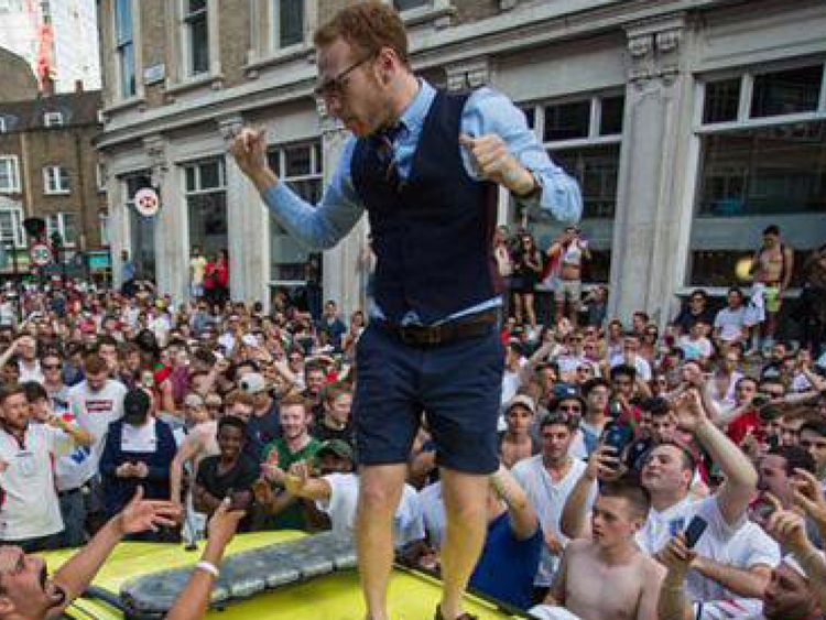 A man wearing a Gareth Southgate style waistcoat was seen on the ambulance roof