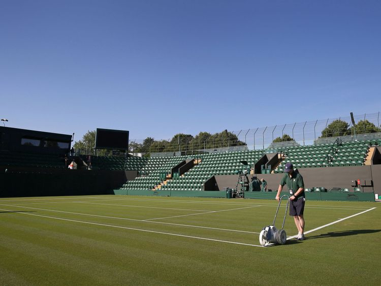 Wimbledon ground staff have said they are working hard to maintain the quality of the grass courts in the heat
