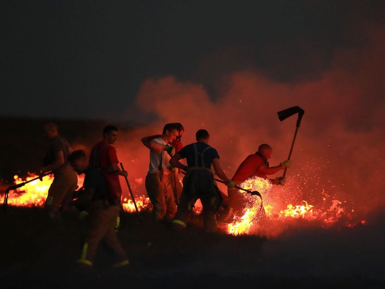 Firefighters tackle a wild fire on Winter Hill near Bolton. PRESS ASSOCIATION Photo. Picture date: Thursday June 28, 2018. See PA story FIRE Saddleworth. Photo credit should read: Danny Lawson/PA Wire