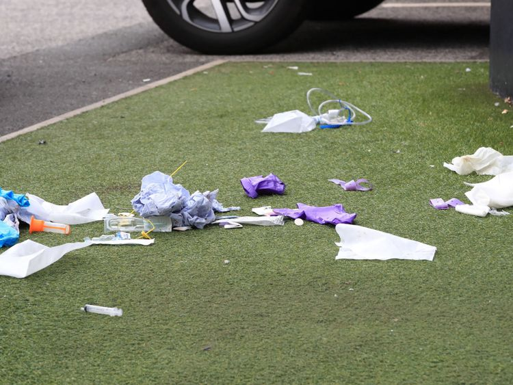Medical equipment strewn outside after a woman was stabbed in Manchester