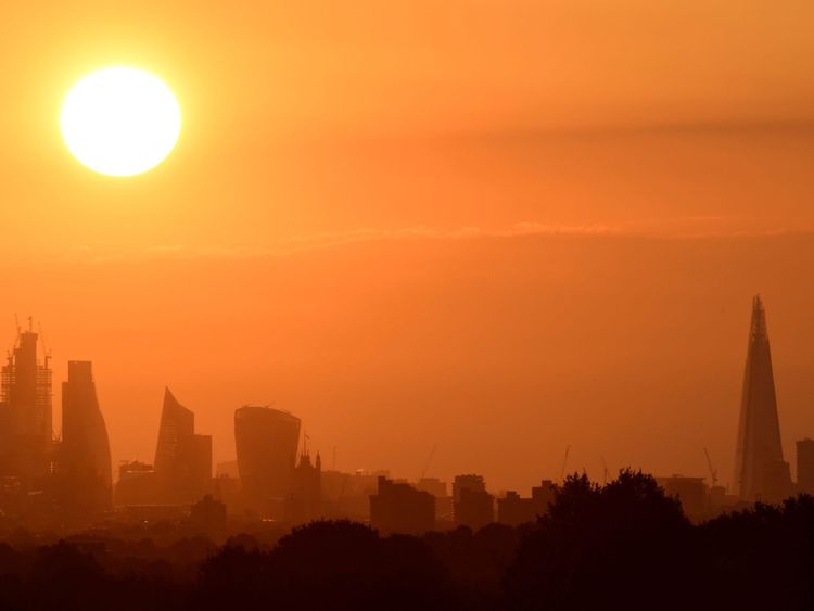 The sun rises behind skyscrapers in the City of London in London, Britain, August 4, 2018. REUTERS/Toby Melville