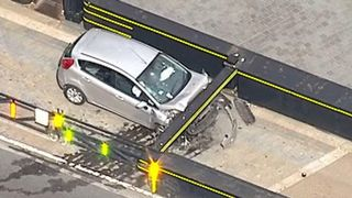 The damage to the front of the car is clearly seen from the air