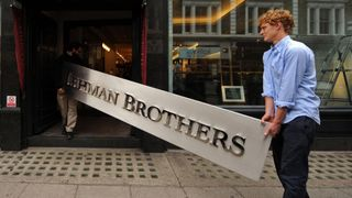 Employees pose for photographers with a Lehman Brothers company sign at Christie's auction house in London on September 24, 2010. The sign will be sold as part of the 'Lehman Brothers: Artwork and Ephemera' sale in London on September 29. AFP PHOTO / BEN STANSALL (Photo credit should read BEN STANSALL/AFP/Getty Images)