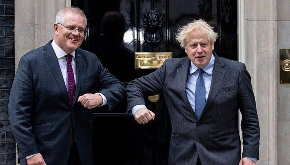 Boris Johnson alongside Australian Prime Minister Scott Morrison (Image: GETTY)
